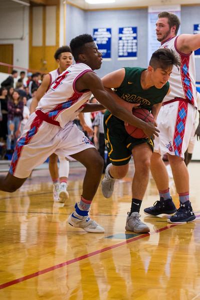 Stephen Watson (34), of Ben Lomond, fouls AJ Juarez (23), of St. Joseph, as Juarez attempts to drive the ball towards the basket, at Ben Lomond High School, in Ogden, on Wednesday, December 6, 2017.