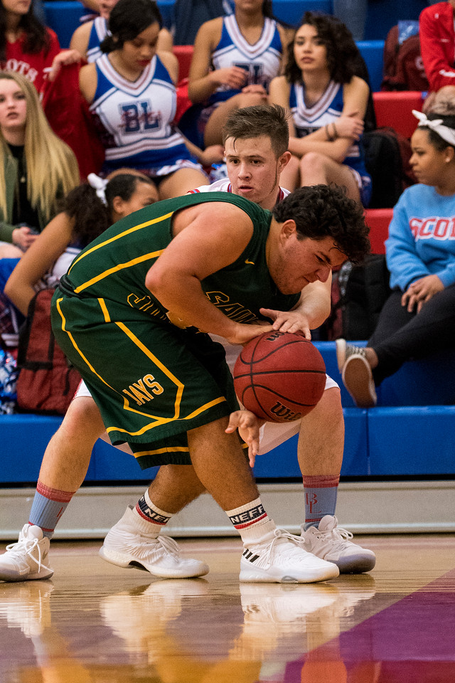 Chad Loe (1), traps St. Joseph's player Nick Garcia (43), on the baseline to force a time out call at Ben Lomond High School, in Ogden, on Wednesday, December 6, 2017.