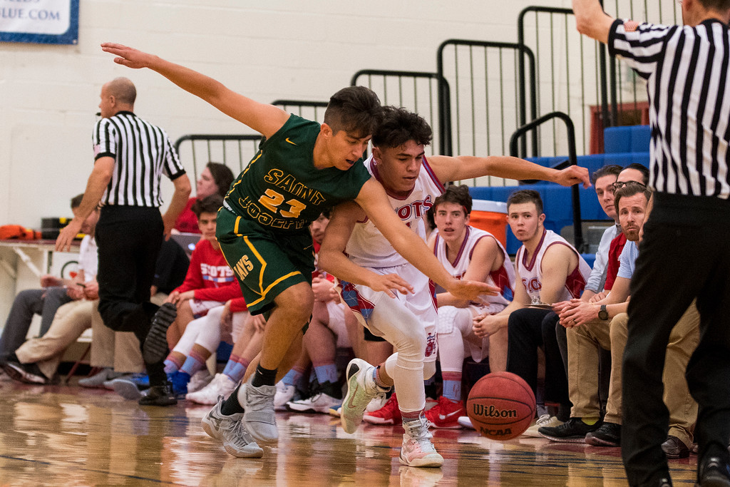 AJ Juarez (23), of St. Joseph, causes a loose ball while defending Ben Lomond player, Juan Espinoza (2), at Ben Lomond High School, in Ogden, on Wednesday, December 6, 2017.