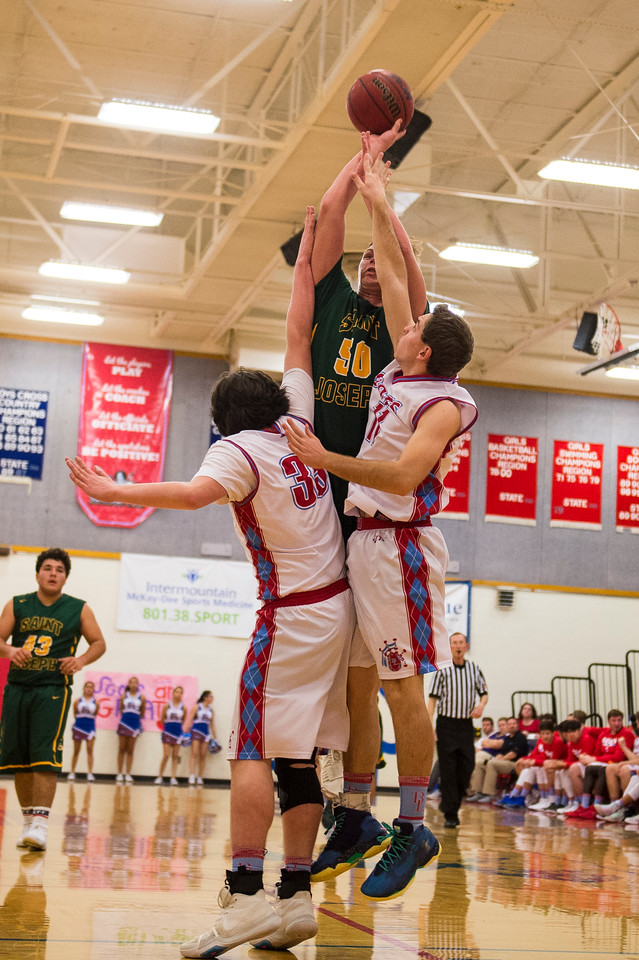 Gavin Anderson (50), of St. Joseph, gets fouled on the shot by the double team of Ben Lomond players Alex Christofferson (35) and Andrew Ormond (11), at Ben Lomond High School, in Ogden, on Wednesday, December 6, 2017.