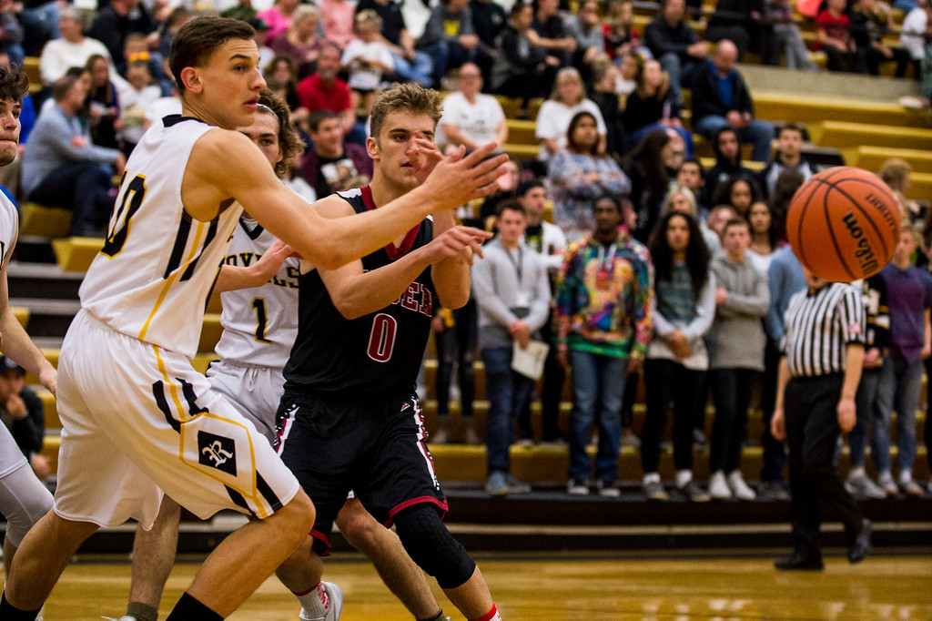 Connor Shaw (0), of Weber High, makes an outlet pass to the perimeter after being stopped by the defense of Alex Lamb (10), of Roy High, at Roy High School in Roy, on Friday, February 3, 2017.