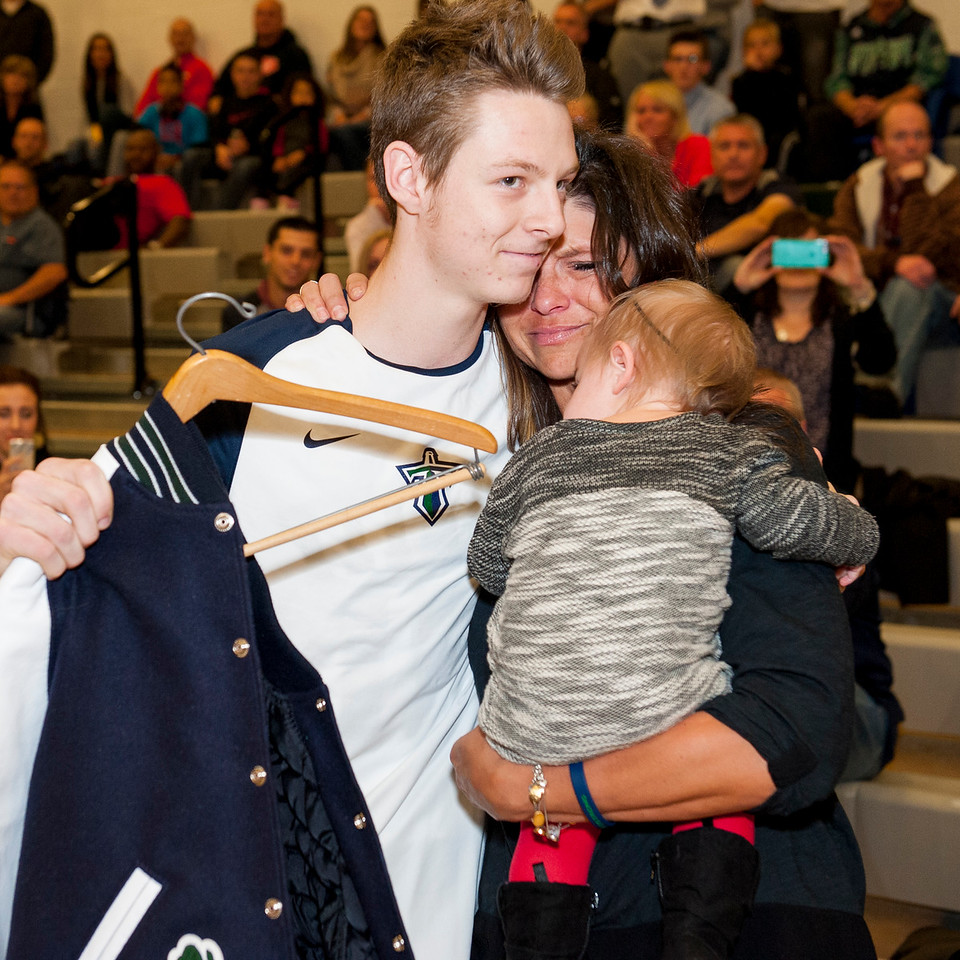 Eileen Whatcott is emotional as she hugs Matthew Conner during a presentation of her son, Jaxon, letterman's jacket before the start of the Titans basketball game at Syracuse High School in Syracuse on December 16, 2015. Whatcott's two sons, Jaxon and Daulton, were former Syracuse basketball players and both passed away in a plane crash in July of 2014.