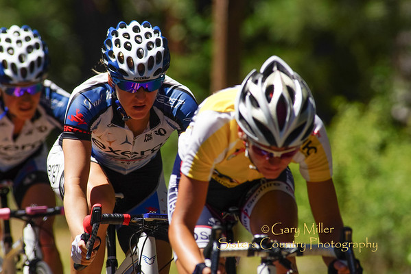 Women's Stage 1 leader Caudia Haeusler of Tibco in the yellow jersey seems to be holding her lead coming down the bottom stretch and curves during the 2013 Cascade Cycling Classic's Wednesday 73 mile McKenzie Pass Road Race stage ran through Sisters, Oregon to Three Creeks Snow Park - Copyright © 2013 Gary N. Miller, Sisters Country Photography