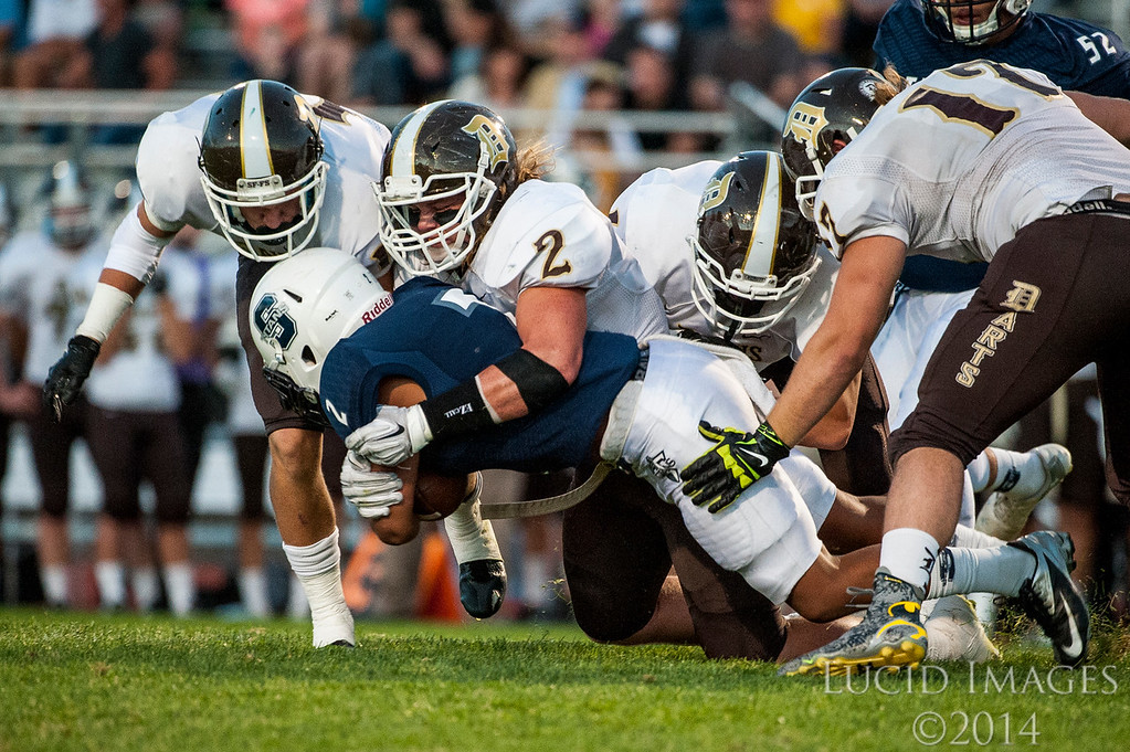 The Davis Darts easily defeat the Syracuse Titans 34-7 at Syracuse High School in Syracuse on September 24, 2015.