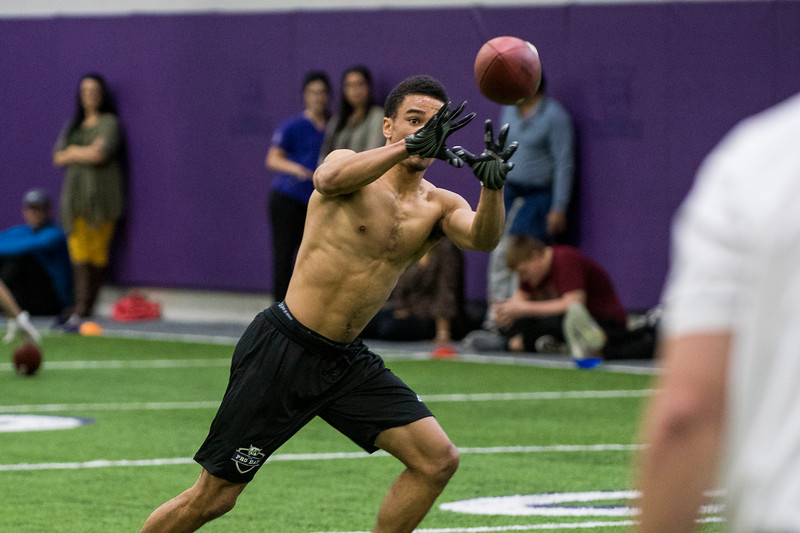 Xequille Harry, of Weber State, lines up to catch a ball during defensive end drills for NFL scouts during Pro Day at the Weber State Field House, in Ogden, on Wednesday, March 28, 2018.