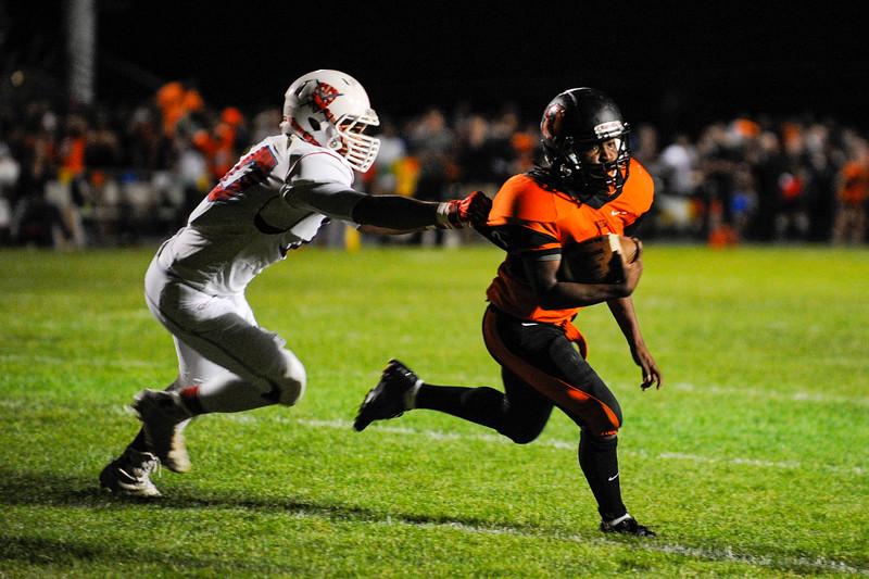 Keith Freeman (7), of the Ogden Tigers narrowly avoids the tackle of Jaime Castillo (10), of the Ben Lomond Scots, to score a touchdown in the final seconds of the first half Ogden High School on September 26, 2014.