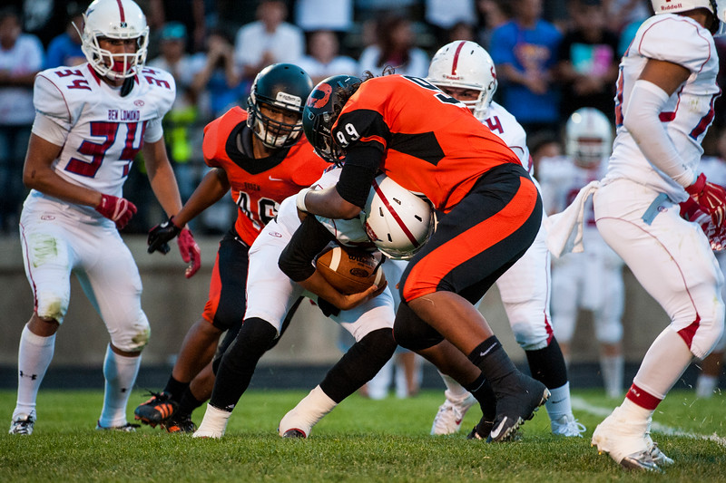 Paul Rodriguez (99) of the Tigers tackles Nova Vasquez (28) of Ben Lomond behind the line of scrimmage at Ogden High School on September 26, 2014.