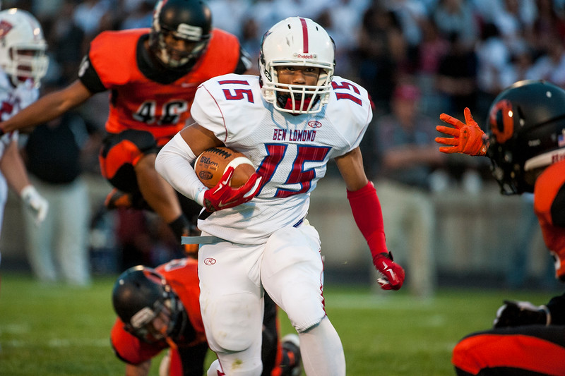 Angelo Rios (15), of the Ben Lomond Scots, runs the ball against the Ogden Tigers in the Iron Horse rivalry game at Ogden High School on September 26, 2014.