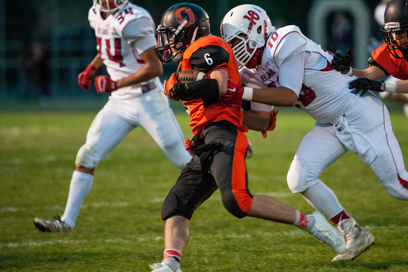 Blake Harvey (6), of the Ogden Tigers, carries the ball against the Ben Lomond Scots in the Iron Horse rivalry game at Ogden High School on September 26, 2014.