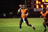 Ogden Tigers quarterback, Cameron Mortensen (4), scrambles out of the pocket only to throw an interception in the end zone against the Ben Lomond Scots at Ogden High School on September 26, 2014.