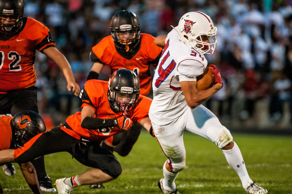 Mario Anderson (34), of the Ben Lomond Scots, runs the ball against the Ogden Tigers in the Iron Horse rivalry game at Ogden High School on September 26, 2014.
