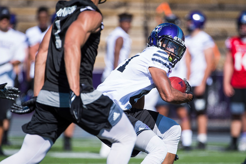 Running back, David Jones (21), carries the ball past his defensive teammates, during the opening day of Weber's training camp, at Stewart Stadium, in Ogden, on Tuesday, August 1, 2017.