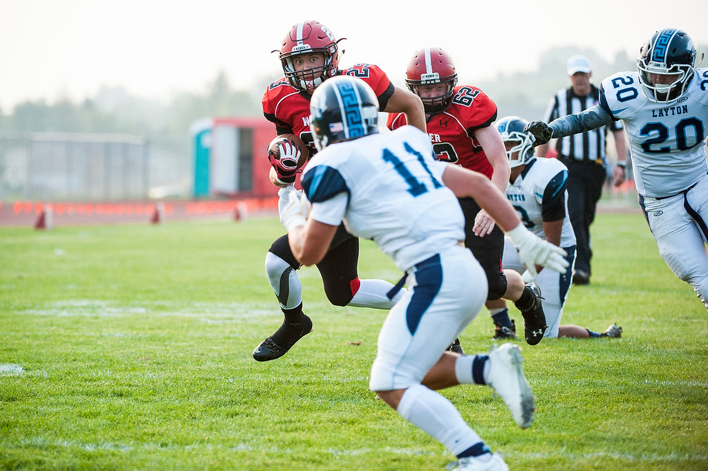 The Weber Warriors took on the Layton Lancers in the football season opener at Weber High School in Pleasant View on August 21, 2015.
