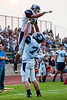 Layton High player Dylan Tucker (74) lifts up teammate Keoni Larsen (3) in celebration after he scores the Lancers first points of the game for a score of 14-7 against the Weber Warriors in the season opener at Weber High in Pleasant View on August 21, 2015.