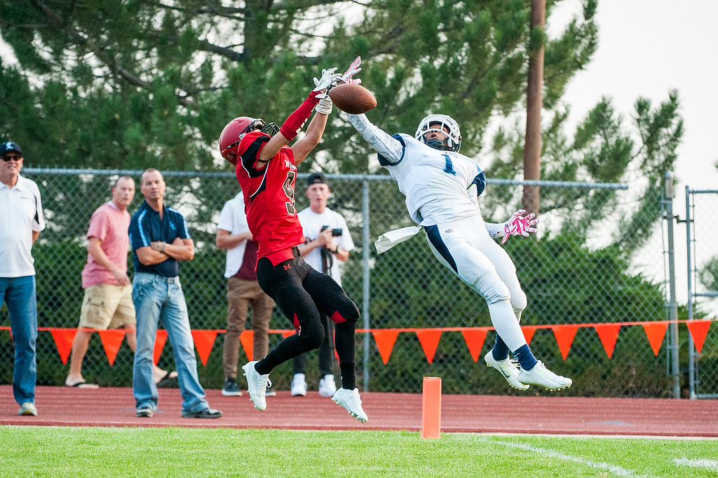 Layton corner back Julian Blackmon (1) goes airborne to deflect the possible touchdown by Weber wide receiver Garrett Hoyt (9) in the first quarter of the season opener at Weber High School in Pleasant View on August 21, 2015.