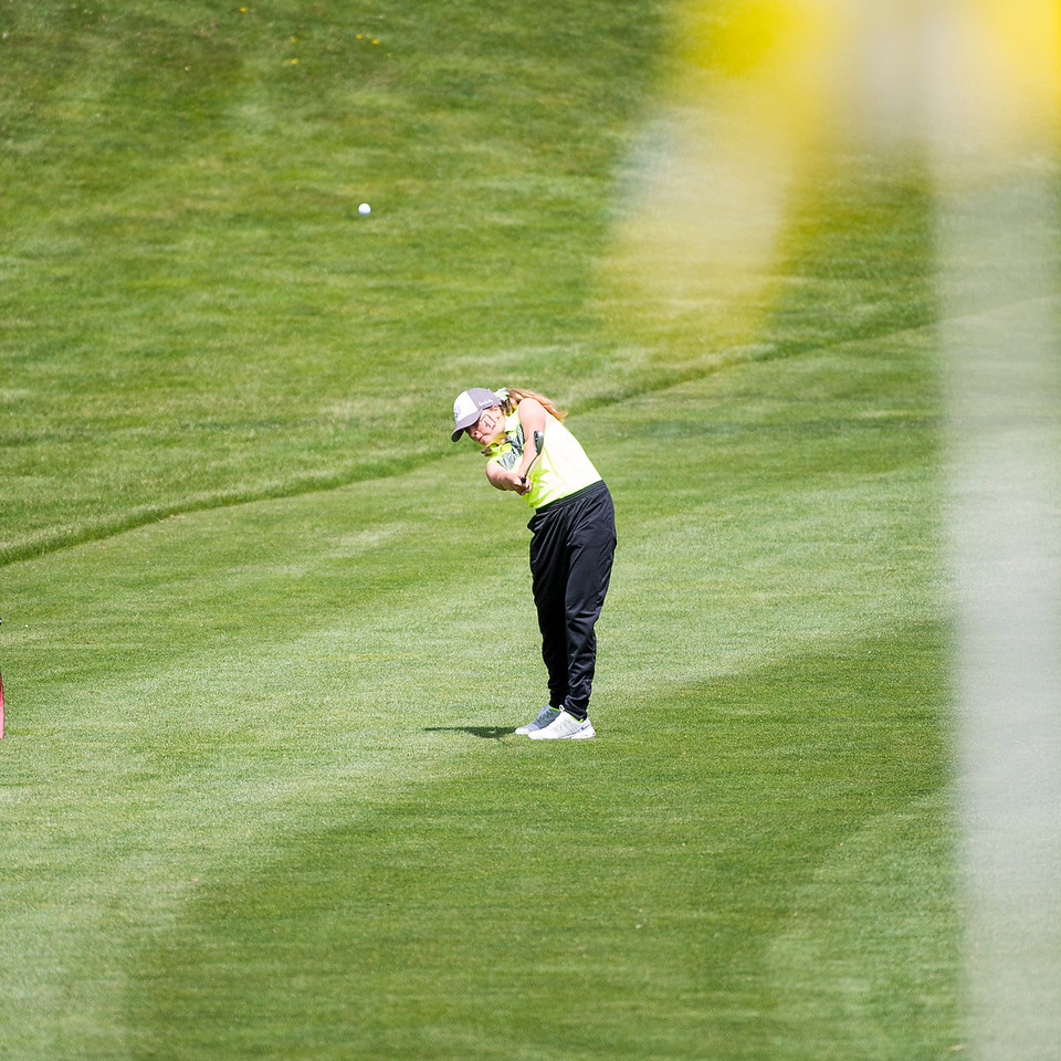 Caylyn Ponich, of Davis High, hits from the fairway to get onto the green of hole 5 in two strokes, during the 5A girls golf state championships at Davis Park Golf Course, in Kaysville, on Tuesday, May 16, 2017.