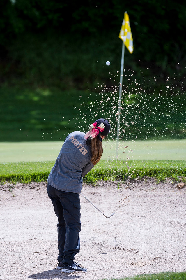 Abbey Porter, of Lone Peak, hits out of the sand trap on hole number 5, during the 5A girls golf state championships at Davis Park Golf Course, in Kaysville, on Tuesday, May 16, 2017.