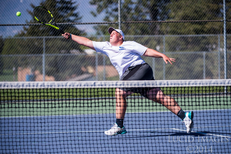 Andrew Nelson, of Fremont High, reaches for a ball that just gets by him while playing against Logan Caseholt, of Roy High, at Roy High School, in Roy, on Thursday, May 4, 2017.