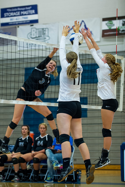 Jantzen Smith (3), of Fremont, gets up to test the defense of Northridge players, Lydia Mashburn (17) and Maddi Vigil (1), at Fremont High School, in Farr West, on September 20, 2016.