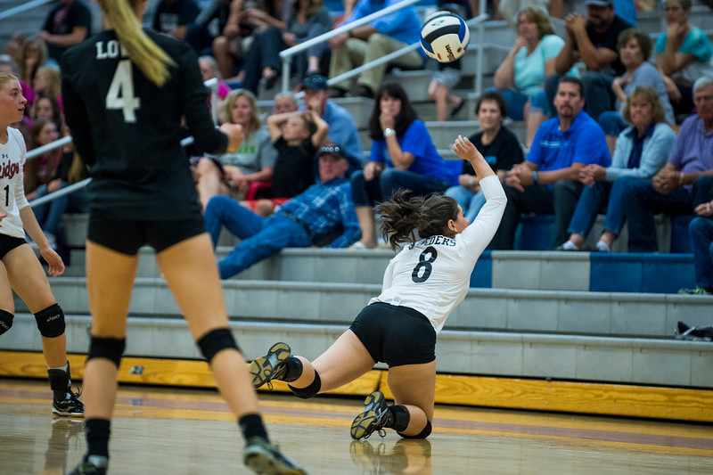 Northridge player, Lexi Lueders (8), dives out of bounds to save a ball during their match against Fremont, at Fremont High School, in Farr West, on September 20, 2016.