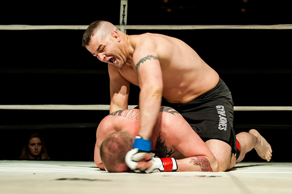 Jacob South (top) lands a series vicious punches on Jared Toothaker (lower), after taking his opponent's back in the main event of Power Promotions' inaugural MMA card at the Davis Conference Center in Layton on April 4, 2015. South controlled the tempo of the fight and forced a submission near the end of the second round.