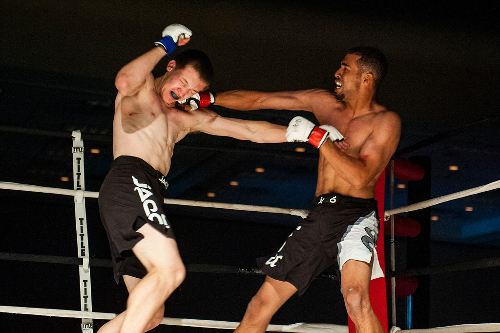 Terrence Curry (right) lands a hard right to his opponent Devin Black (left) during their bout at Power Promotions' inaugural MMA card at the Davis Conference Center in Layton on April 4, 2015.
