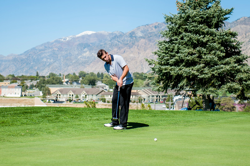 Zach Hood, of Bonneville High, puts for par on hole number 13 at Eagle Mountain Golf Course, in Brigham City, on September 26, 2016.
