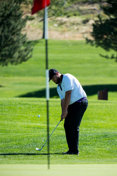 Nick Colling, of Box Elder High, chips onto the green of hole 10 for a bogey at Eagle Mountain Golf Course, in Brigham City, on September 26, 2016.