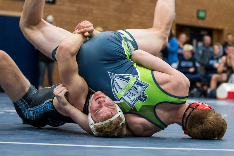 Alec Bolingbroke (left), of Layton High, fights to keep Samuel Sphren (right), out of bounds on his way to winning the match at Layton High School, in Layton, on Thursday, January 18, 2018.