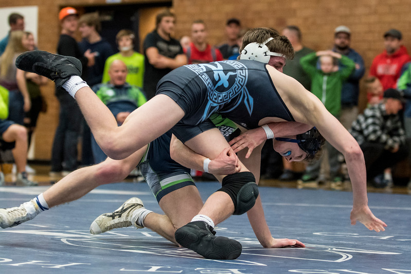 Mitch Parker (rear), of Syracuse, tries to flip his opponent, Terrell Barraclogh (front), of Layton, to the ground, on his way to winning the match at Layton High School, in Layton, on Thursday, January 18, 2018. Barraclough would win the match in the 132 pound weight class.
