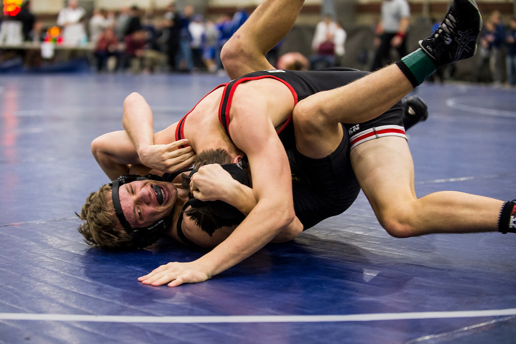 Thomas Atkinson (top), of American Fork, tries to pin down Noland Jensen (bottom), of Roy High, in the 5A divisional tournament to qualify for the state wrestling championships at the Legacy Events Center in Farmington, on Thursday, February 2, 2017.