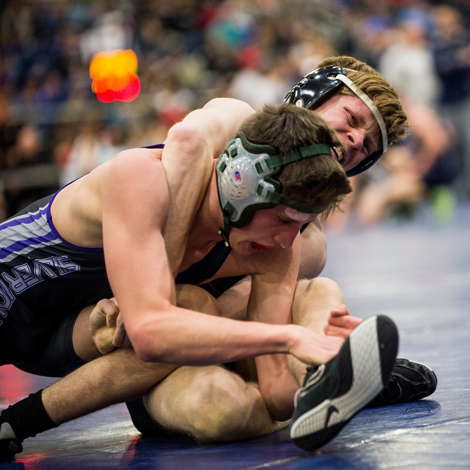 Aaron Webb (right), of Layton High, fights for control against his opponent Trevor Chabries (left), of Riverton High, in the 5A divisional tournament to qualify for the state wrestling championships at the Legacy Events Center in Farmington, on Thursday, February 2, 2017.