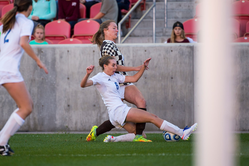 Madison Nicholls (6), of Fremont High, slides in to try to prevent the ball from going out of bounds against Davis High player, Olivia Wade (10), during the 5A girls soccer championship at Rio Tinto Stadium in Sandy on October 21, 2016. Davis High would go on to win the game 2-1 against Fremont.