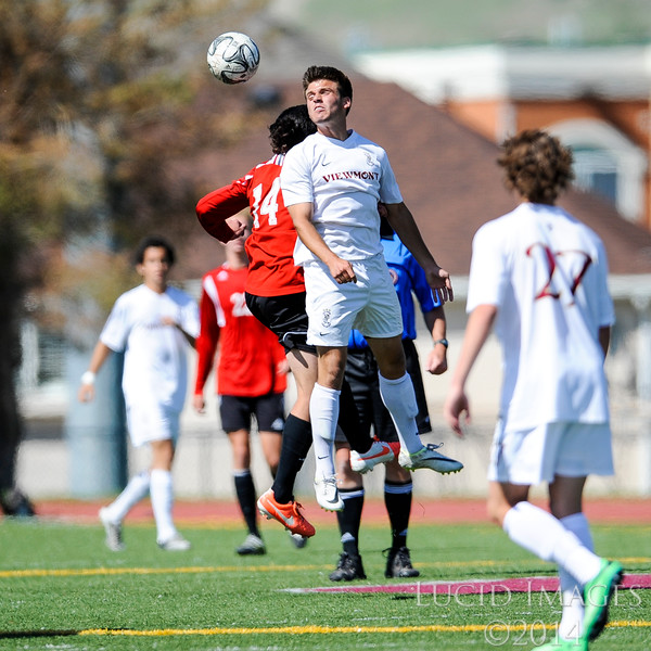 Lucas Cawley of Viewmont goes for a header to control the ball during the first round of soccer playoffs. Viewmont controlled the pace and scoring of the whole game and would go on to win 3-0 over American Fork High School at Viewmont High School in Bountiful on May 13, 2014. (ROBBY LLOYD/ Special to the Standard-Examiner)