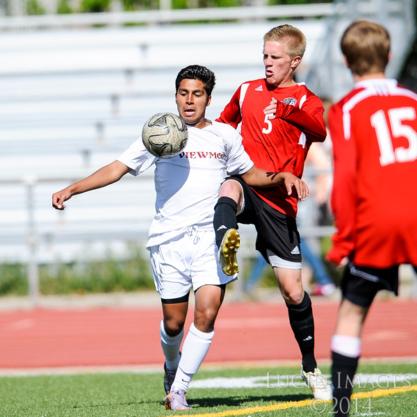 Bryan Correa (in white) of Viewmont fights for control over the ball against Kyle Woolstenhulme of American Fork. Viewmont kept American Fork's defense busy all game and won 3-0 in the first round of the playoffs at Viewmont High School in Bountiful on May 13, 2014. (ROBBY LLOYD/ Special to the Standard-Examiner)