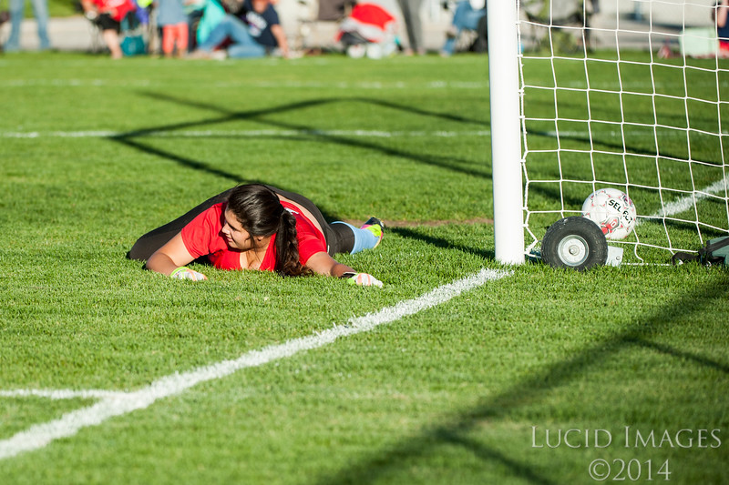 Ben Lomond goalie Jenny Barrandey (12), looks up after diving just short of blocking a goal made by Bear River in their 3-0 loss in the 3-A girls prep soccer playoffs at Box Elder High School in Brigham City on October 12, 2015.