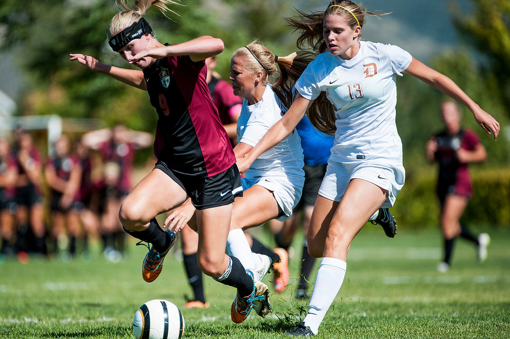 Davis player Megan Rowe (13) works with teammate Mikayla Colonna (21) to steal the ball away from Viewmont player Sam Draxler (9) during the Darts 5-2 victory over the Lady Vikings in Kaysville on September 10, 2015.