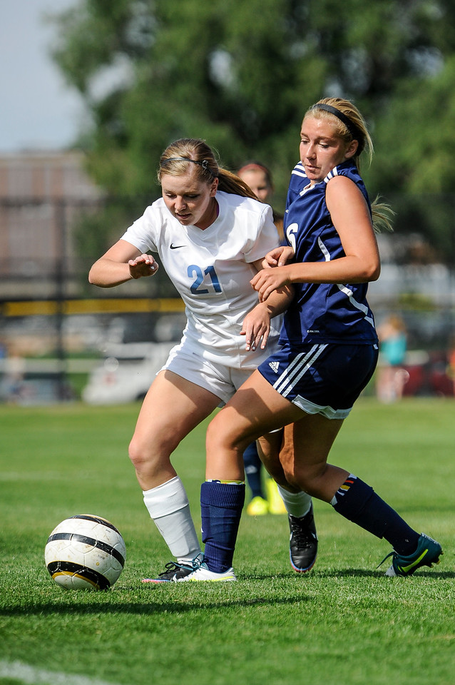Shaylee Carper (21), of Layton High School, fights to keep the ball in bounds against Kathryn Markham (16), of Syracuse, in the Lancers' 4-2 victory in Layton on September 4, 2014. (ROBBY LLOYD/Standard-Examiner)