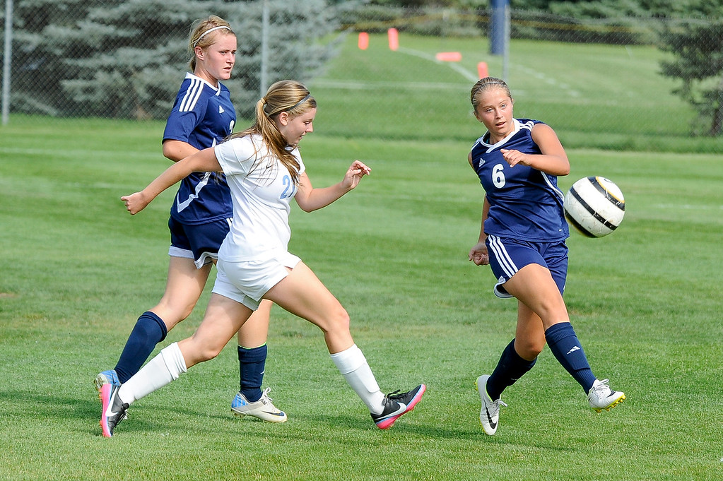 Courtnee Bearnson (6), of Syracuse High School, kicks the ball out of bounds to slow down the advance of Layton High School's offense. Layton controlled the game from early on and would go on to win 4-2, thanks to three goals by Kenzie Humpherys. Photo taken in Layton on September 4, 2014. (ROBBY LLOYD/Standard-Examiner)
