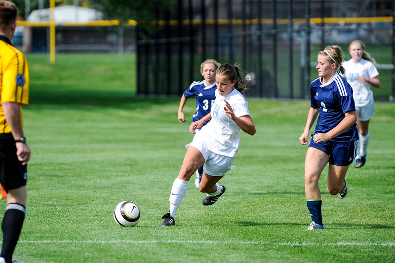 Anne Bitner (14), of Layton High School, works to advance the ball up the field against Syracuse High in the Lancers' 4-2 victory in Layton on September 4, 2014. (ROBBY LLOYD/Standard-Examiner)