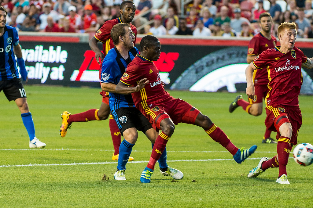 Omar Holness (12), of Real Salt Lake, gets ahead of Yura Movsisyan (14), of the Montreal Impact, to gain control of the ball at Rio Tinto Stadium in Sandy, Utah on July 9, 2016.