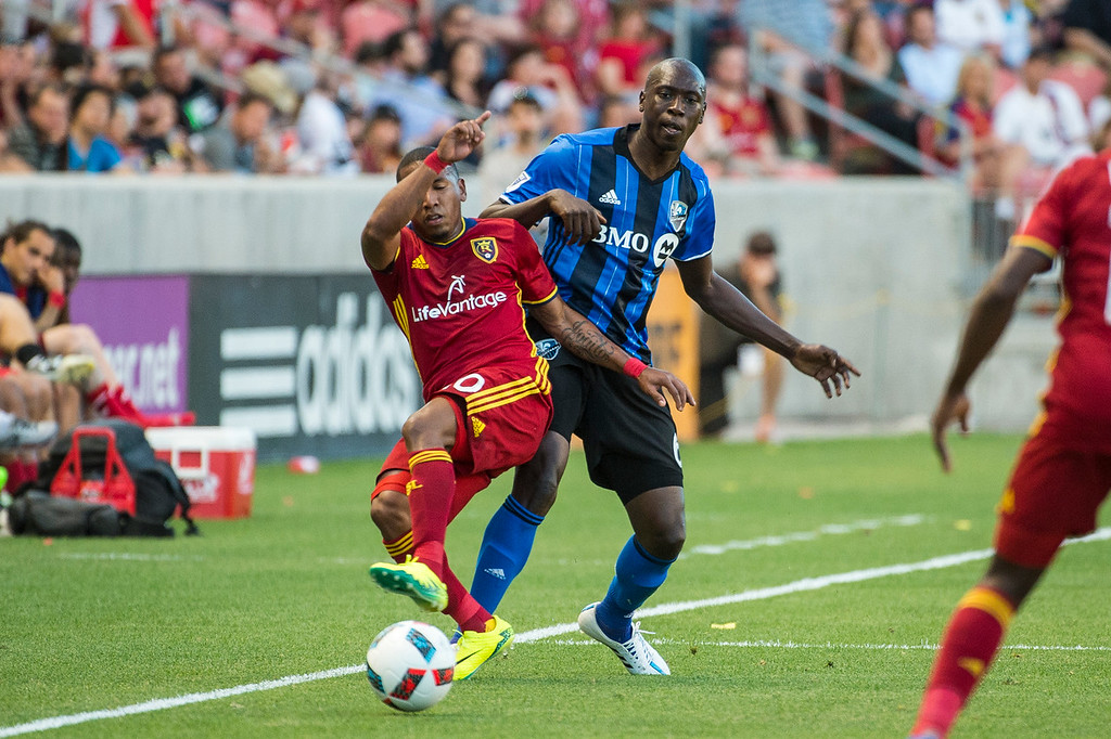 Hassoun Camara (6), of the Montreal Impact, works against the defense of Real player, Joao Plata (10), of Real Salt Lake, at Rio Tinto Stadium in Sandy, Utah on July 9, 2016.