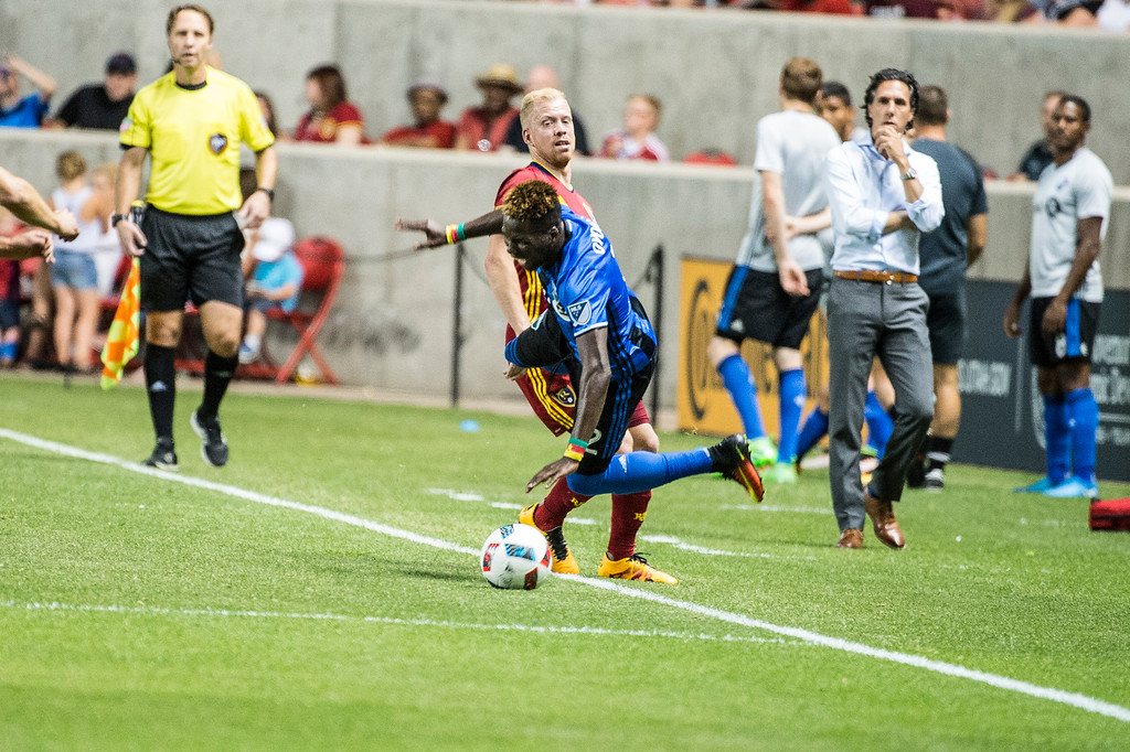Chris Wingert (16), of Real Salt Lake, gets a yellow card after fouling Ambroise Oyongo (2), of the Montreal Impact at Rio Tinto Stadium in Sandy, Utah on July 9, 2016.