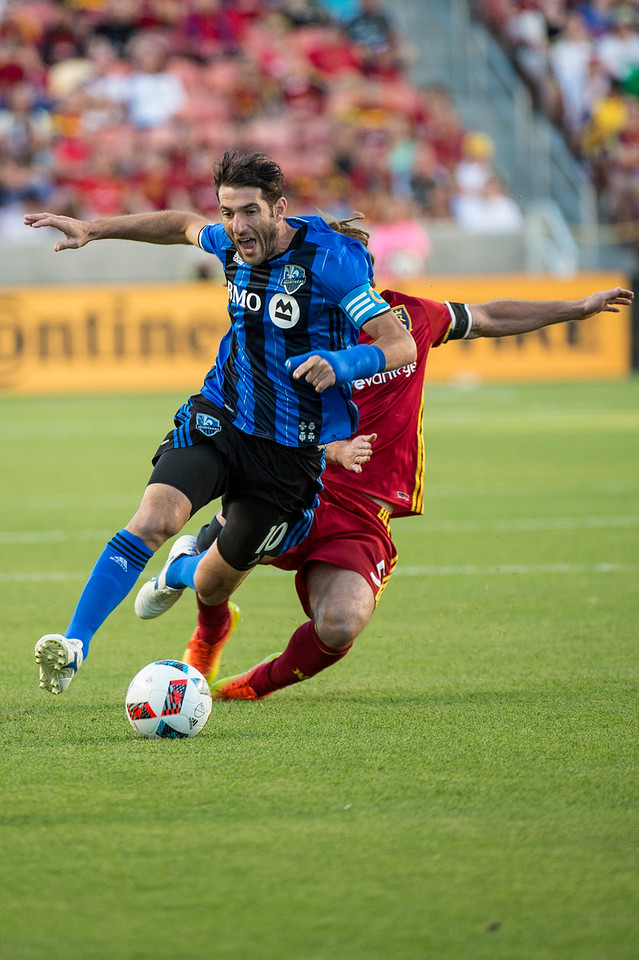 Ignacio Piatti (10), of the Montreal Impact, hustles to get past the defense of Real Salt Lake player, Kyle Beckerman (5), at Rio Tinto Stadium in Sandy, Utah on July 9, 2016.