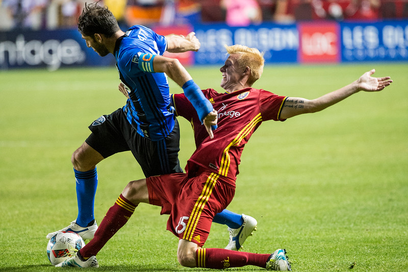 Ignacio Piatti (10), of the Montreal Impact, gets taken down by Real Salt Lake player, Justen Glad (15), near the goal box, at Rio Tinto Stadium in Sandy, Utah on July 9, 2016.