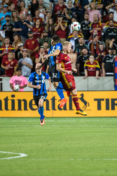 Luke Mulholland (17), of Real Salt Lake, goes up for a header, against Montreal player, Lucas Ontivero (32), at Rio Tinto Stadium in Sandy, Utah on July 9, 2016.