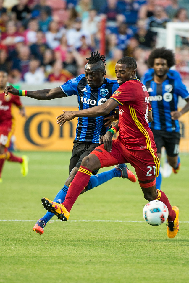 Montreal forward, Dominic Oduro (7), hustles to get control of the ball against the defense of Aaron Maund (21), of Real Salt Lake, at Rio Tinto Stadium in Sandy, Utah on July 9, 2016.