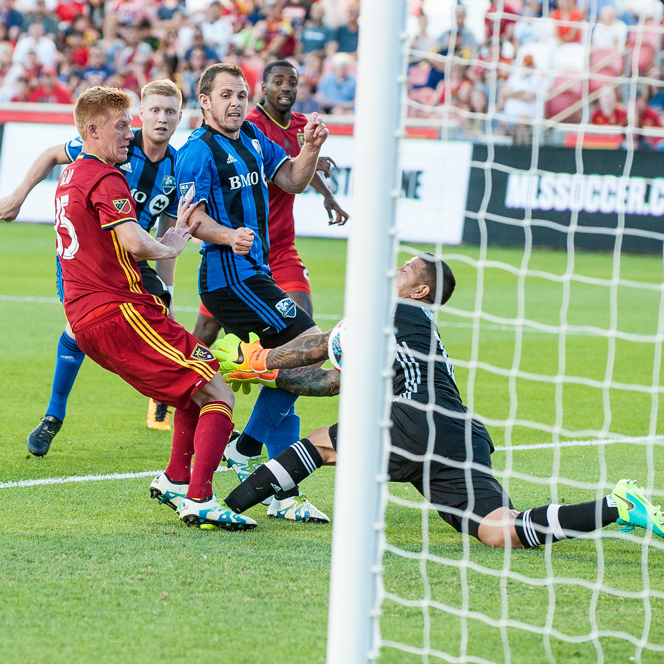 Harry Shipp (14), of the Montreal Impact, scores the only goal of the first half past the Real Salt Lake goalie, Nick Rimando (18), at Rio Tinto Stadium in Sandy, Utah on July 9, 2016.
