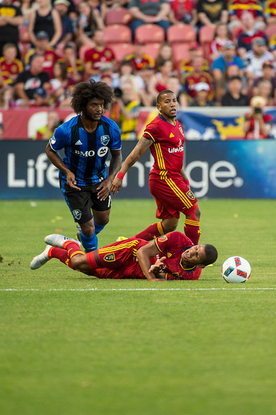 Omar Holness (12), of Real Salt Lake, goes down in front of Michael Salazar (19), of the Montreal Impact, after some aggressive maneuvering in midfield at Rio Tinto Stadium in Sandy, Utah on July 9, 2016.
