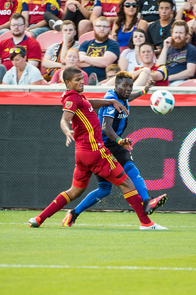 Ambroise Oyongo (2), of the Montreal Impact, crosses the ball past the front of the Real goal while fending off the defense of Omar Holness (12), of Real Salt Lake, at Rio Tinto Stadium in Sandy, Utah on July 9, 2016.